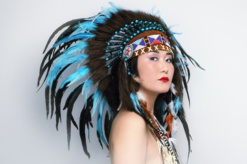Young beautiful asian woman in vintage costume of American Indian