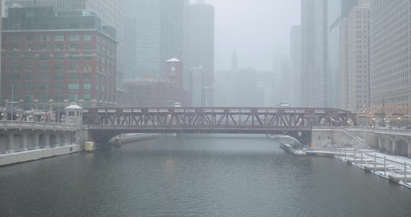 Fototapete - Chicago river train moving in snow