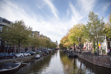 Typical view of canal embankment in historic center of city, Amsterdam, Netherlands.