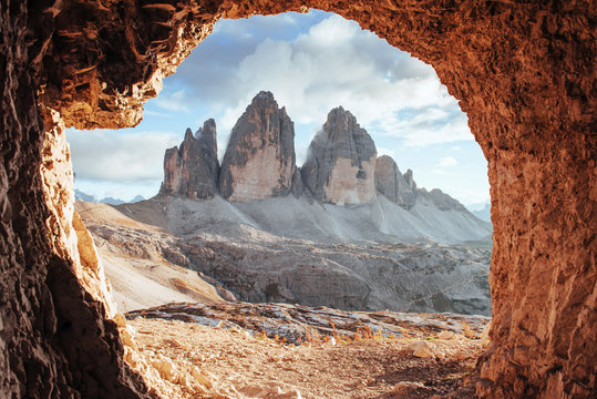 Cloudy sky. Tre Cime mountains of three peaks. Gorgeous photo in the sunny day. Italian landscapes