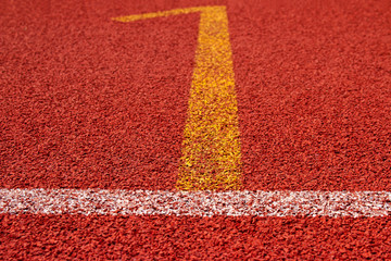 Red running track Synthetic rubber on the athletic stadium.