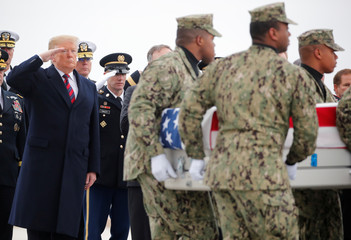 Dignified transfer ceremony for four Americans killed in Syria is attended by President Trump at Dover Air Force Base in Delaware