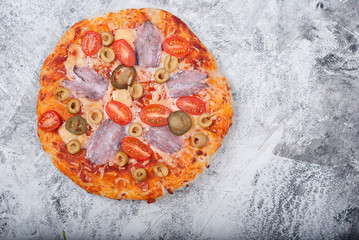 homemade pizza on grey background
