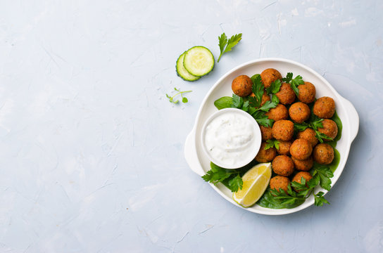Fresh Falafel with Yogurt Sauce on Plate, Vegetarian Meal