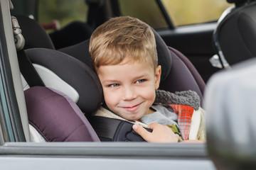 Cute little boy in car sitting in car seat