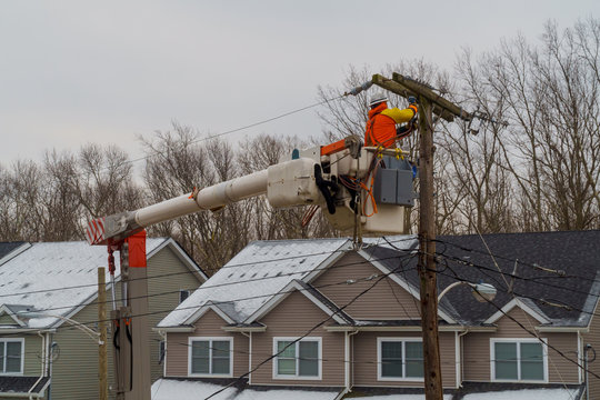 Electric power pole. Wire breakage after snow storm hurricane. Broken power line.