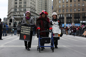 Mary Lutz, Corinne Willinger and Alice Storm Sutter of the Raging Grannies, attend the Women's Unity Rally in New York City