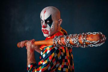 Mad bloody clown with baseball bat