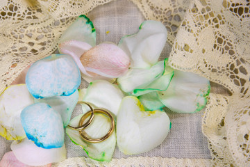 Mens wedding bands with rainbow rose petals