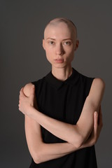 bald girl posing in Studio in black dress