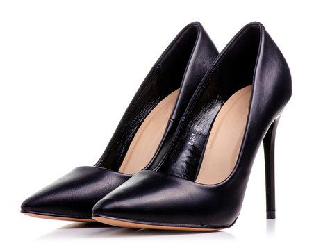 Female black leather high heels shoes on white background isolation
