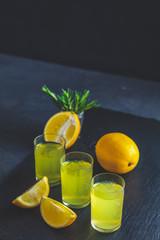 Lemon alcohol drink liqueur limoncello with pieces of lemon