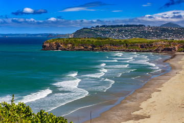 New Zealand, South Island. Dunedin. Tomahawk Beach. There is Dunedin city in the background