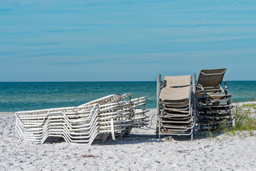 Beach chairs stacked at end of the day