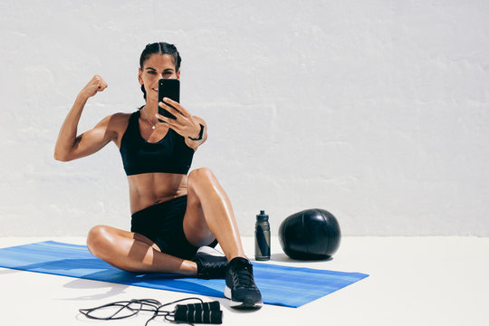 Fitness woman taking a selfie during workout