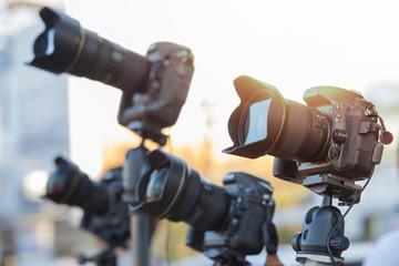 Professional modern DSLR camera on  tripod,Many DSLR cameras on a tripod, Closeup of a camera on tripod outdoors