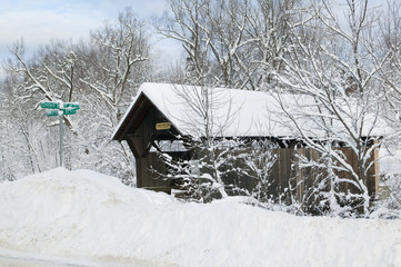 A snow blanketed Emily's covered bridge in Stowe Vermont, USA