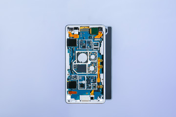 Parts of disassembled smartphone. Details of disassembled smartphone open view