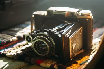 Old retro camera. Vintage still life. Vintage background