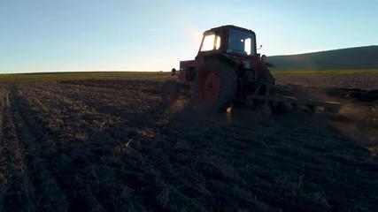 Wall Mural - Harvest fields with tractor. Farmer plowing stubble field.