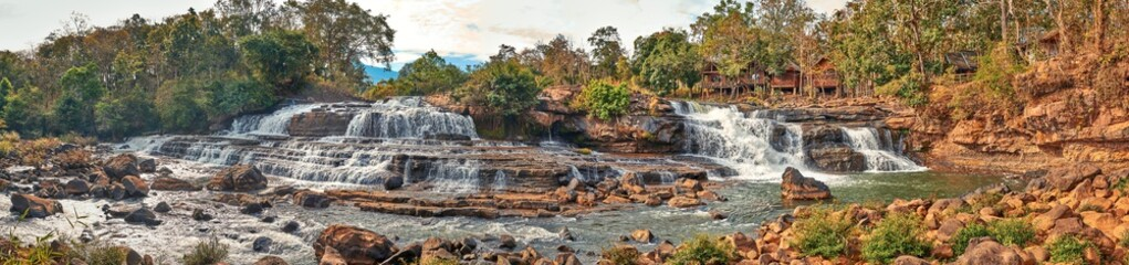 Beautiful waterfall in the tropical jungles panoramic sunset view