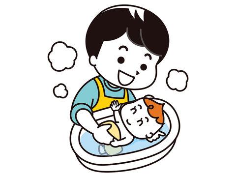 赤ちゃんを沐浴させるお父さん