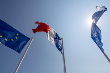 French, European and Hotel Beau Rivage flags on Promenade des Anglais in Nice France