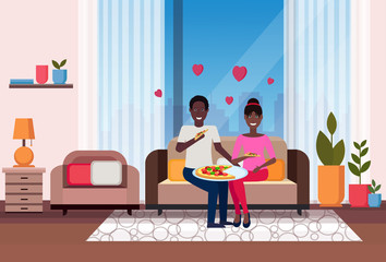happy couple eating pizza african american man woman sitting on couch modern apartment home living room interior male female cartoon characters flat horizontal