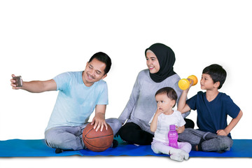 Muslim family taking picture after exercises