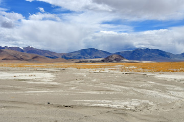 China, Tibet. Transhimalayas on the way to the lake, Ngangla Ring Tso in the summer in cloudy day