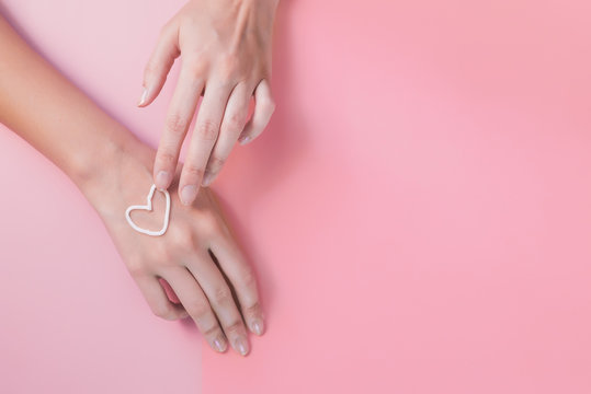 hand cream. like a heart. the concept of skin care, hydration and nutrition. manicure, soft hands, velvety soft skin. youth
