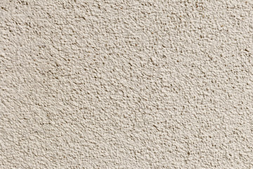 wall. plaster applied to it. composition of small stones. and in a special way pounded