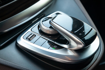 The interior elements of a new expensive business Mercedes V-class car inside with multimedia system control joystick