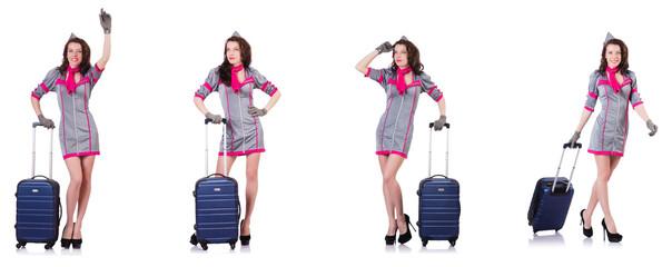 Beautiful stewardess with suitcase isolated on white