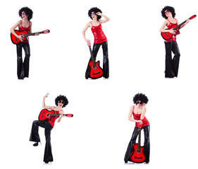 Woman in afro wig playing guitar