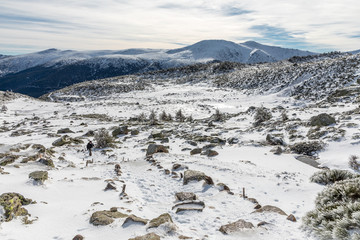 Way of ascent to the lagoons of Peñalara in the mountain range of Madrid covered by snow.
