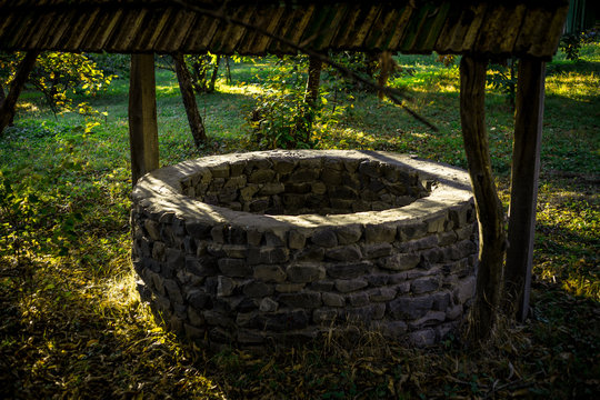 Abandoned well in the forest. Waiting for a terrible girl with a long hair.