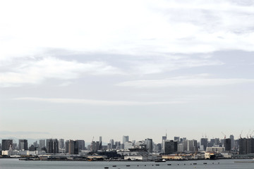 A scenery of a high-rise apartment that stands on the waterfront in Tokyo