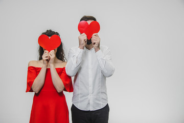 Beautiful attractive, cheerful, positive pair. Married Spouse is a husband of a husband. Hold hands, hiding the closing eyes of the little small cards.