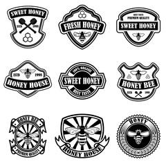 Set of vintage honey labels template. Bee icons. Design element for logo, label, emblem, sign, poster.