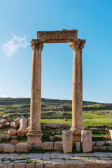 Ancient ruined architecture with meadow in Jerash, Amman, Jordan