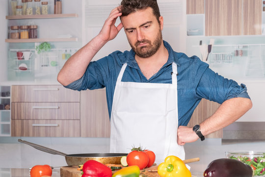 Worried man before cooking at home for dinner