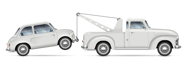 Retro tow truck towing a small car, view from side. Roadside assistance lorry with vintage mini car on white background. All elements in the groups on separate layers for easy editing and recolor