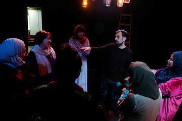 """Palestinian women listen to the producer as they prepare to perform a play titled """"Us Too, Women of Palestine"""", inspired by Greek tragedian Aeschylus's ÒThe Suppliant WomenÓ, in Ramallah, in the Israeli-occupied West Bank"""