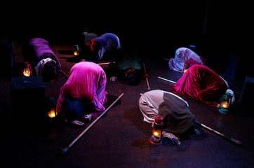 """Palestinian women perform a play titled """"Us Too, Women of Palestine"""", inspired by Greek tragedian Aeschylus's ÒThe Suppliant WomenÓ, in Ramallah, in the Israeli-occupied West Bank"""