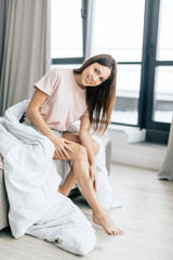 depilation and epilation concepts. full length photo.charming pretty model resing in the bed . awesome housewife posing to the camera