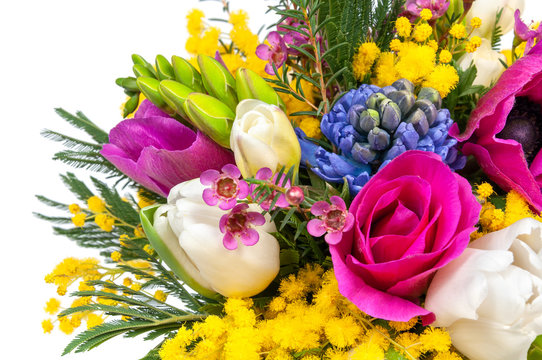 Elite spring bouquet with mimosa and other flowers, close up on a white background