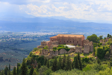 distant view on Paleolog castle in Mystras against Laconia valley