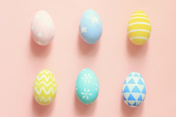 Pastel and colorful tone easter eggs on colorful background