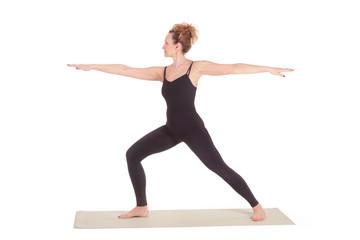 Beautiful Yoga: Senior Woman doing Virabhadrasana Warrior one pose